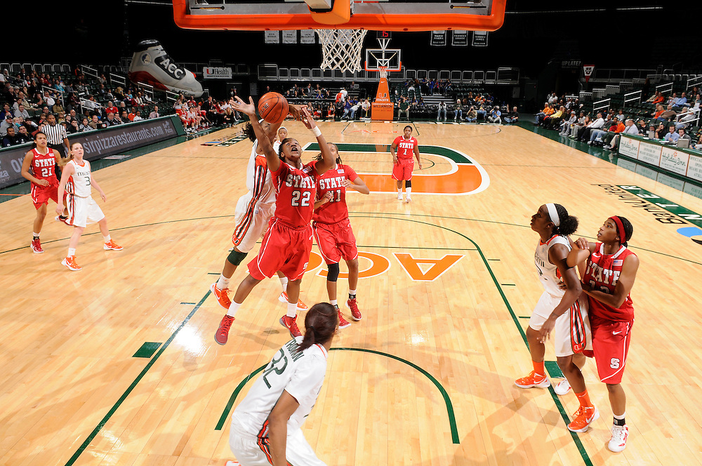 January 5, 2012: Bonae Holston #22 of North Carolina State has a shot blocked from behind by Sylvia Bullock #34 of Miami during the NCAA basketball game between the Miami Hurricanes and the North Carolina State Wolfpack at the BankUnited Center in Coral Gables, FL. The Hurricanes defeated the Wolfpack 78-68.
