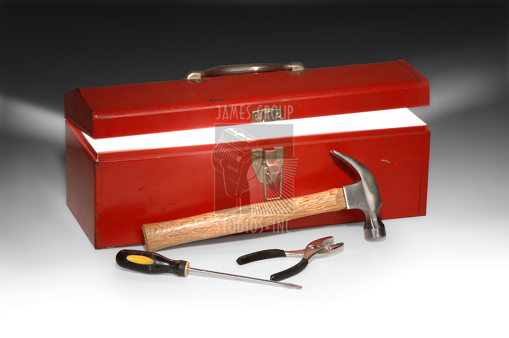 Red toolbox partially opened with light rays emitting from inside the box