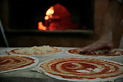 Pizza's about to go into the oven at Pizzeria Ai Marmi or Pizzeria Panattoni, Frommer's Italy Day By Day