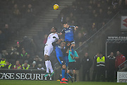 Swindon Town defender Raphael Rossi Branco (29) heads the ball during the EFL Sky Bet League 1 match between Milton Keynes Dons and Swindon Town at stadium:mk, Milton Keynes, England on 30 December 2016. Photo by Dennis Goodwin.