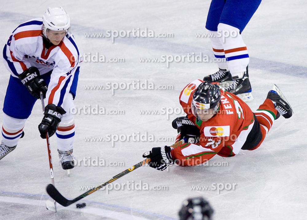 BLAGUS Mislav of Croatia vs FEKETE Dániel of Hungary  at IIHF Ice-hockey World Championships Division I Group B match between National teams of Hungary and Croatia, on April 20, 2010, in Tivoli hall, Ljubljana, Slovenia.  (Photo by Vid Ponikvar / Sportida)