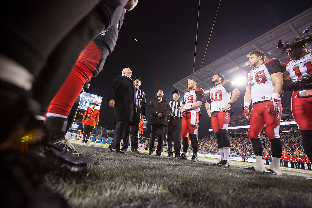 Governor General David Johnston flips the coin at the 104th Grey Cup Final game between the Calgary Stampeders and Ottawa Redblacks in Toronto Ontario, Sunday,  November 27, 2016.  (CFL PHOTO - Geoff Robins)
