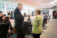 29 AUG 2018, BERLIN/GERMANY:<br /> Horst Seehofer (L), CSU, Bundesinnenminister, und Angela Merkel (R), CDU, Bundeskanzlerin, im Gespraech, vor Beginn der Kabinettsitzung, Bundeskanzleramt<br /> IMAGE: 20180829-01-050<br /> KEYWORDS: Kabinett, Sitzung, Gespräch