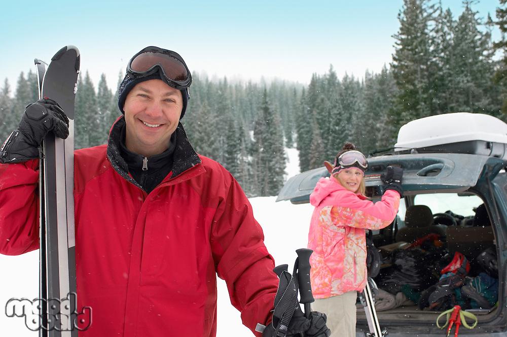 Happy Couple Ready to Go Skiing