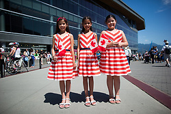 From left to right, ten-year-old triplets, Elizabeth Ferguson, Danielle Ferguson and Chloe Ferguson, who were born in the United Arab Emirates, pose for a photograph after receiving their Canadian citizenship during a special Canada Day ceremony in Vancouver, B.C., on Saturday July 1, 2017. Photo by Darryl Dyck/CP/ABACAPRESS.COM