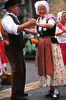 Middle-aged couple dancing at a festival in Provence, France