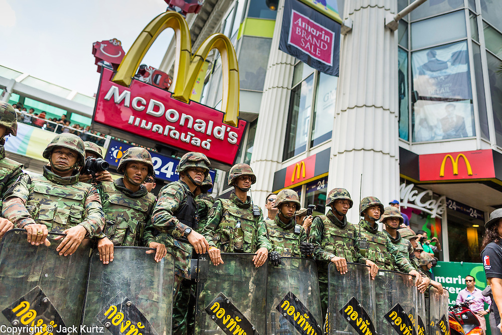 25 MAY 2014 - BANGKOK, THAILAND: Thai soldiers on duty against protestors in front of a McDonald's in Bangkok. Public opposition to the military coup in Thailand grew Sunday with thousands of protestors gathering at locations throughout Bangkok to call for a return of civilian rule and end to the military junta.     PHOTO BY JACK KURTZ