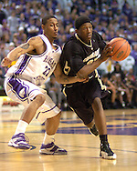 Colorado guard Marcus Hall (R) drives against Kansas State's Mario Taybron (L) during the first half of the Wildcats 72-60 win over the Buffaloes at Bramalage Coliseum in Manhattan, Kansas, February 18, 2006.