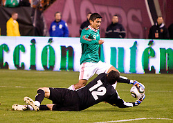 February 24, 2010; San Francisco, CA, USA;  Bolivia goalkeeper Carlos Lampe (12) saves a shot from Mexico forward Alberto Medina (9) during the second half at Candlestick Park. Mexico defeated Bolivia 5-0.