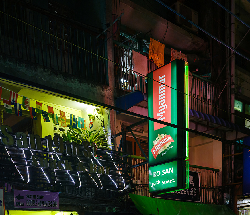 YANGON, MYANMAR - CIRCA DECEMBER 2017: Sign of restaurant in Chinatown at night, the area is popular with backpackers due to the street food stalls and vendors.