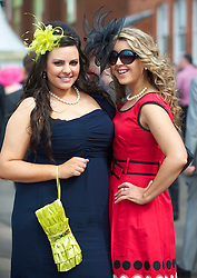 LIVERPOOL, ENGLAND - Friday, April 9, 2010: Laura Johnson (L) and Helen Wynn-Hughes from Nantwich attend Ladies' Day during the second day of the Grand National Festival at Aintree Racecourse. (Pic by David Rawcliffe/Propaganda)