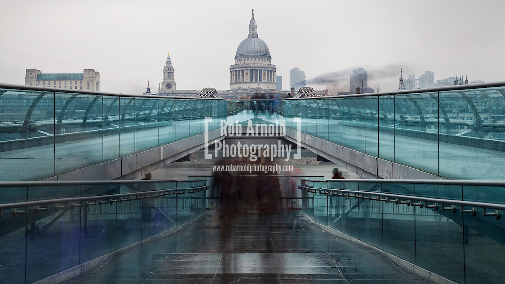 07/03/2013, Millennium Bridge, London, UK. A view looking over the Millennium Bridge to St. Paul's Cathedral on a cold and grey afternoon. Photo by Rob Arnold