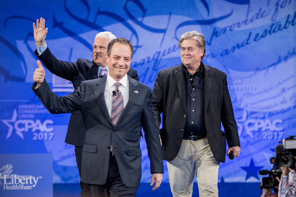 President and White House chief strategist Steve Bannon and White House Chief of Staff Reince Priebus talk at the CPAC, Conservative Political Action Conference. Behind Priebus is moderator Matt Schlapp.