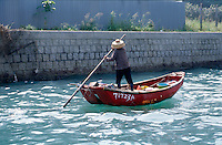 A woman in her boat at the harbor in Aberdeen, Hong Kong, China.