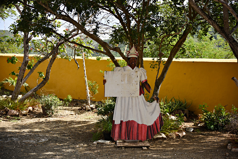 WILLEMSTAD, CURACAO - DECEMBER 10, 2014:  A cardboard cutout of a traditional Curacao woman stands greeting visitors at the Landaus Knip and Tula Museum. Tula is one of the national heroes, who was executed while leading the island's slave rebellion in 1795. (photo by Melissa Lyttle)