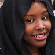 Portrait of smiling African American Muslim teenage girl wearing headscarf at the American Muslim Day Parade in New York City