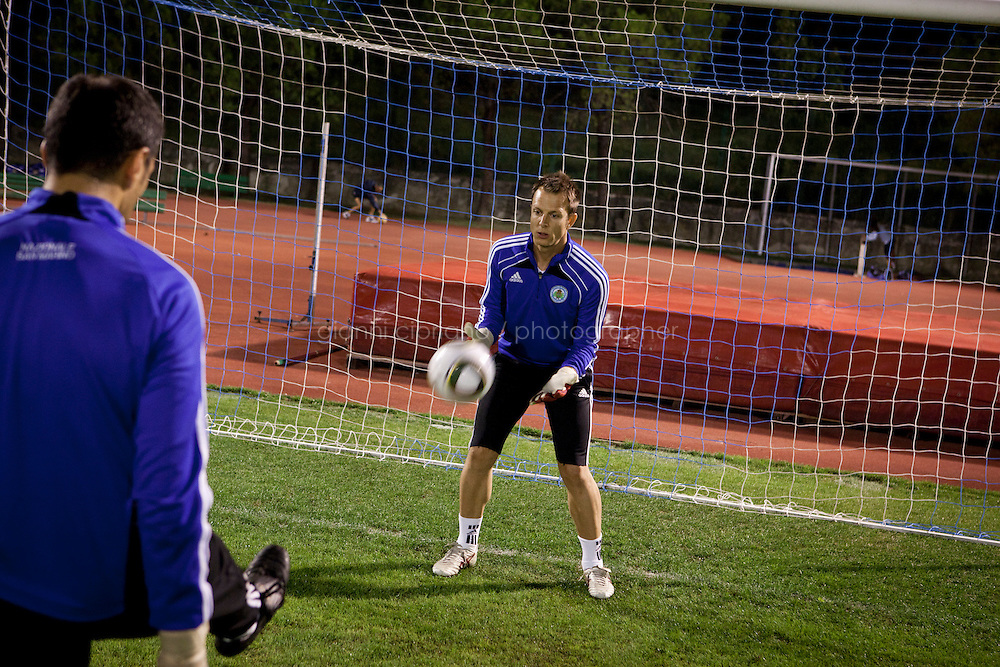 SERRAVALLE, SAN MARNO - 3 OCTOBER 2011:  Federico Valentini, 29, who works as a bank clerk and plays as backup goalkeeper in the San Marino national team, trains at the Olympic Stadium before the upcoming and last Euro 2012 qualification game against Moldova on October 11, in San Marino on October 3, 2011. Before a recent game against Sweden, the starting keeper got hurt, so they called Valentini in the bank in the morning to ask if he could play. He did, and played well. The San Marino national football team is the last team in the FIFA  World Ranking (position 203). San Marino, whose population reaches 30,000 people, has never won a game since the team was founded in 1988. They have only ever won one game, beating Liechtenstein 1&ndash;0 in a friendly match on 28 April 2004. The Republic of San Marino, an enclave surronded by Italy situated on the eastern side of the Apennine Moutanins, is the oldest consitutional republic of the world<br /> <br /> <br /> ph. Gianni Cipriano