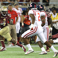 Florida State Seminoles running back Dalvin Cook (4) runs the ball during a NCAA football game between the Ole Miss Rebels and the Florida State Seminoles at Camping World Stadium on September 5, 2016 in Orlando, Florida. (Alex Menendez via AP)