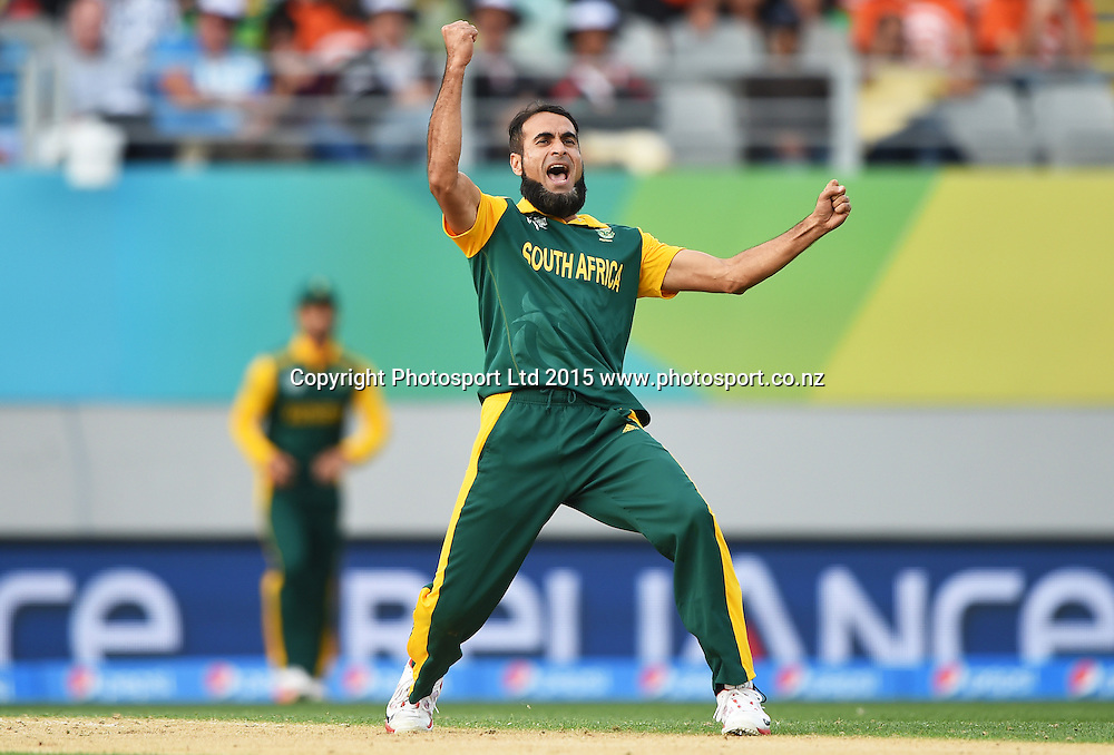 South African bowler Mohammad Imran Tahir celebrates the LBW wicket of Wahab Riaz during the ICC Cricket World Cup 2015 match between South Africa and Pakistan at Eden Park, Auckland. Saturday 7 March 2015. Copyright Photo: Andrew Cornaga / www.Photosport.co.nz