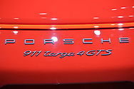 Manhattan, New York, USA. April 12, 2017.  A red Porsche 911 targa 4 GTS, name detail seen in close-up, is on display at the New York International Auto Show, NYIAS, during the first Press Day at the Javits Center.
