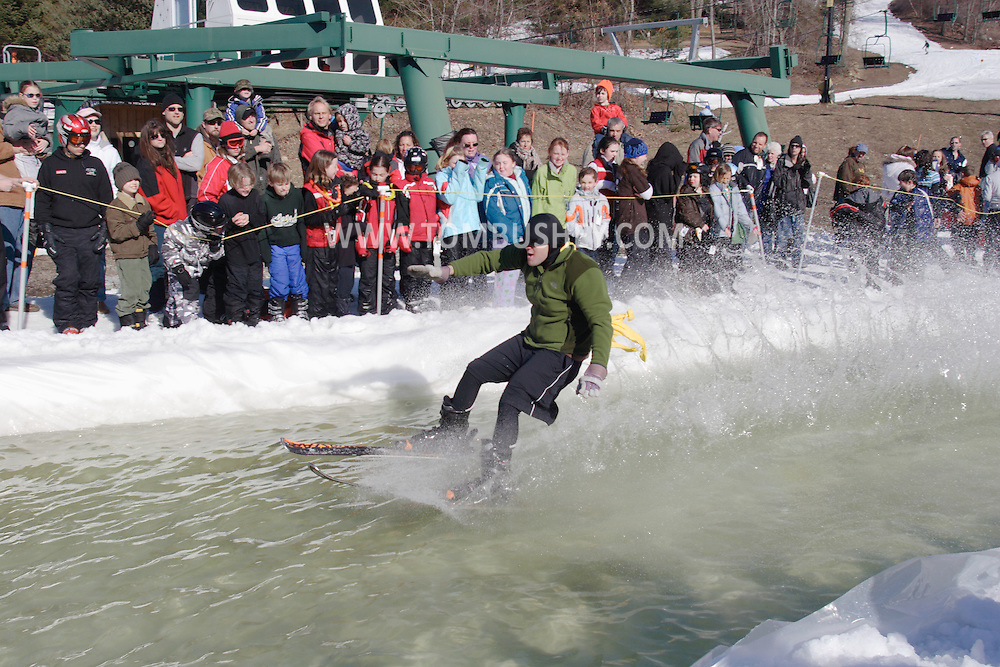 Warwick, NY - A skier crosses the water at the end of a run during the Spring Rally at Mount Peter on March 29, 2008.