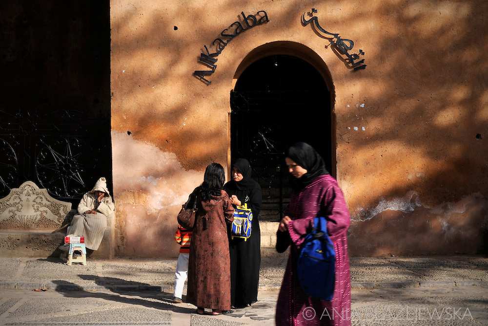 Morocco, Chefchaouen. Women near the old kasbah situated in the centre of the town.