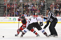 Mar 15; Newark, NJ, USA; New Jersey Devils center Adam Henrique (14) wins a face off against Colorado Avalanche center Ryan O'Reilly (37)  during the second period at the Prudential Center.