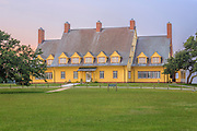 The Whalehead Club and live oaks at sunrise in Corolla on the Outer Banks, NC.
