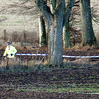 Police cordon off the scene where a Bell Jet Ranger 206B helicopter crashed into a field beside the A94 Coupar Angus to Meigle road, in which two men were killed. The helicopter was being flown from Cumbernauld to Aberdeen conducting a gas pipe patrol for tthe National Grid.<br /> <br /> Picture by Graeme Hart.<br /> Copyright Perthshire Picture Agency<br /> Tel: 01738 623350  Mobile: 07990 594431