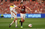 20.10.2013 Sydney, Australia. Wellingtons midfielder Vince Lia and Wanderers Croatian midfielder Mateo Poljak in action during the Hyundai A League game between Western Sydney Wanderers FC and Wellington Phoenix FC from the Pirtek Stadium, Parramatta. The game ended in a 1-1 draw.