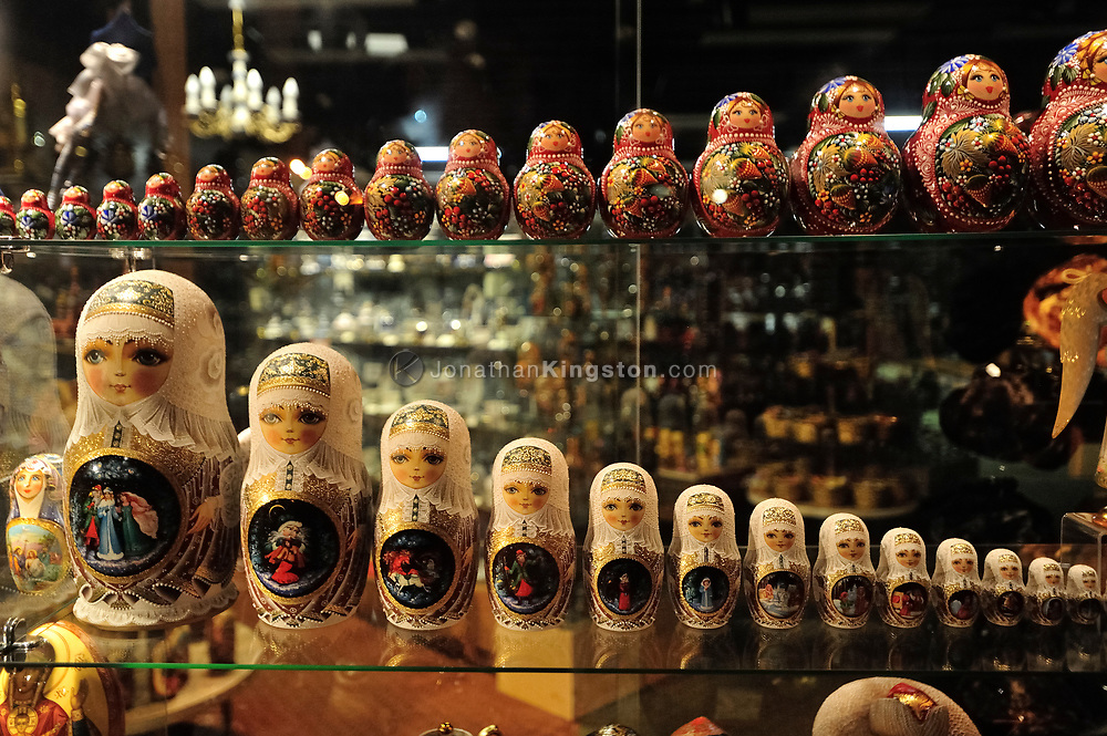 Matryoshka doll's on display in a shop window in Sitka, Alaska at night.