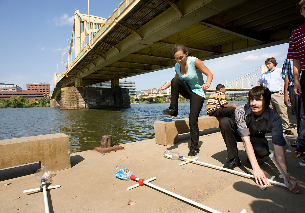 City Charter High School student Shalyce Blankenship (left) launches her paper rocket with help from her lab partner Matyas Feher beneath the Andy Warhol Bridge at Allegheny Riverfront Park during engineering class. The students were learning about flight engineering.