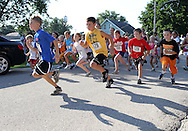 Tyson Helms (from left), 10, Austin Miller, 9, Dakota Dudley, 7, and Dylan Dudley, 7, all of Walker, take off in the one mile kid's fun run at the Walker Pickle Days in Walker on Saturday, July 30, 2011. Helms came in first at 6:53 and Miller came in second at 7:00.