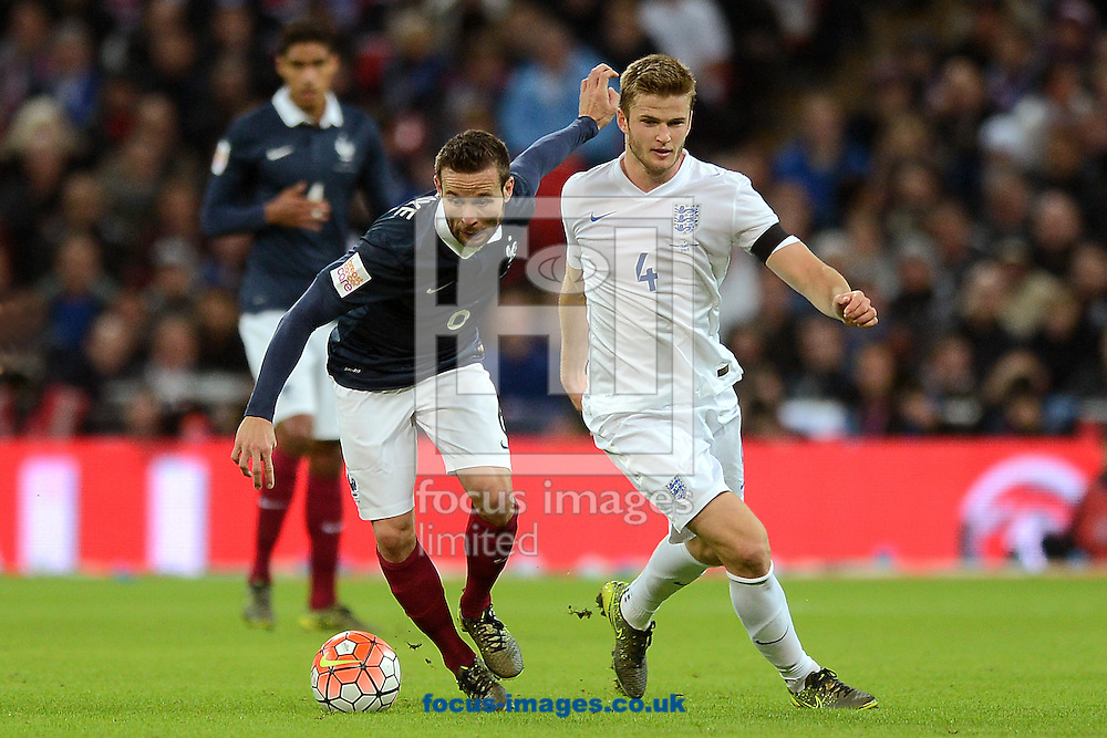 Eric Dier of England does battle with Yohan Cabaye of France during the Breast Cancer Care International Friendly match between England and France at Wembley Stadium, London<br /> Picture by Richard Blaxall/Focus Images Ltd +44 7853 364624<br /> 17/11/2015