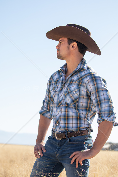 rugged All American cowboy looking off
