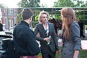 Jamie Campbell Bower;; Zoe Graham, 2009 Serpentine Gallery Summer party. Sponsored by Canvas TV. Serpentine Gallery Pavilion designed by Kazuyo Sejima and Ryue Nishizawa of SANAA. Kensington Gdns. London. 9 July 2009.