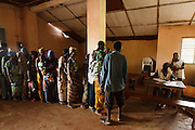 Flood victims wait in line during a UNICEF-sponsored distribution session in Athieme, Benin  on Monday October 25, 2010. UNICEF donated water treatment tablets, mosquito nets and soap to affected families, while other partner organizations offered blankets, floormats, and buckets.