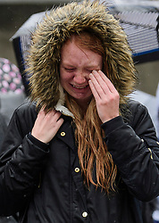 © Licensed to London News Pictures. 06/06/2017. London, UK.  Nicola Smith, the ex-girlfriend of attack victim James McMullan, is comforted by her sister during a minutes silence at London Bridge in central London for those who lost their life in a terrorist attack on Saturday evening. Three men attacked members of the public  after a white van rammed pedestrians on London Bridge.   Ten people including the three suspected attackers were killed and 48 injured in the attack. Photo credit: Ben Cawthra/LNP