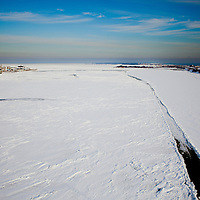 As seen from atop of the Highlands bridge, Highlands New Jersey the Shrewbury River has completely frozen over with ice due to a extended period of freezing temperatures.   To the left is the Highlands and the Right is Sandy Hook National Park.