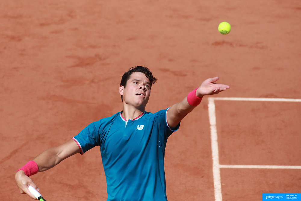 2017 French Open Tennis Tournament - Day Two.  Milos Raonic of Canada in action against Steve Darcis of Belgium on court number two during the Men's Singles Round one match at the 2017 French Open Tennis Tournament at Roland Garros on May 29th, 2017 in Paris, France.  (Photo by Tim Clayton/Corbis via Getty Images)