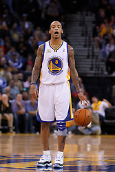 Feb 2, 2012; Oakland, CA, USA; Golden State Warriors shooting guard Monta Ellis (8) dribbles the ball against the Utah Jazz during the second quarter at Oracle Arena. Golden State defeated Utah 119-101. Mandatory Credit: Jason O. Watson-US PRESSWIRE