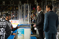 KELOWNA, CANADA - OCTOBER 5: Referee Chris Crich stands at the bench and speaks to Kelowna Rockets' coaches Jason Smith and Travis Crickard against the Victoria Royals  on October 5, 2018 at Prospera Place in Kelowna, British Columbia, Canada.  (Photo by Marissa Baecker/Shoot the Breeze)  *** Local Caption ***