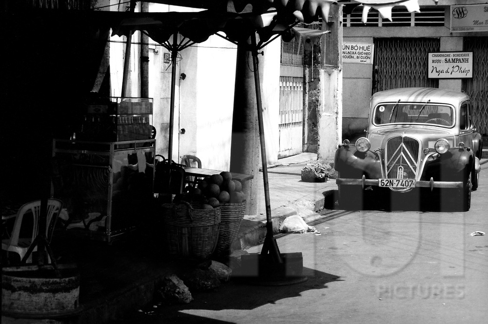 An old Citroën car 'traction' is parked in a street of Ho Chi Minh city, Vietnam, Asia.1996