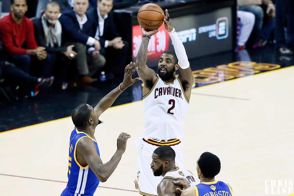 09 June 2017: Cleveland Cavaliers guard Kyrie Irving (2) takes a jump shot over Golden State Warriors forward Kevin Durant (35) during the Cleveland Cavaliers 137-11 victory over the Golden State Warriors, in game 4 of the 2017 NBA Finals, at  the Quicken Loans Arena, Cleveland, Ohio, USA.
