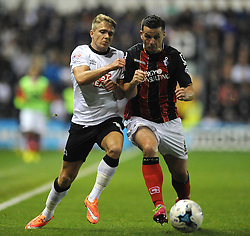 Derby County's Jamie Ward races Bournemouth's Ian Harte - Photo mandatory by-line: Dougie Allward/JMP - Mobile: 07966 386802 - 30/09/2014 - SPORT - Football - Derby - Pride Park - Derby County v AFC Bournemouth - Sky Bet Championship
