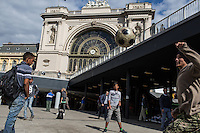 Young refugees play soccer at the makeshift refugee camp at the Budapest Keleti railway station.<br /> <br /> <br /> Hundreds of refugees from mostly Syria and Afghanistan gather at the Budapest Keleti railway station waiting for trains to leave for destinations such as Austria, Germany and Sweden, in Budapest, Hungary, on Tuesday, Sept. 8, 2015. Hungary's Prime Minister Viktor Orban created an anti-refugee campaign to generate hate against those fleeing war in their home countries. The country is currently 50% xenophobic and the government has become increasingly authoritarian.