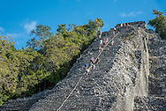The Ancient Pyramid at the Mayan archeological site of Coba is still open to the public to climb its approximately 130 narrow steps.
