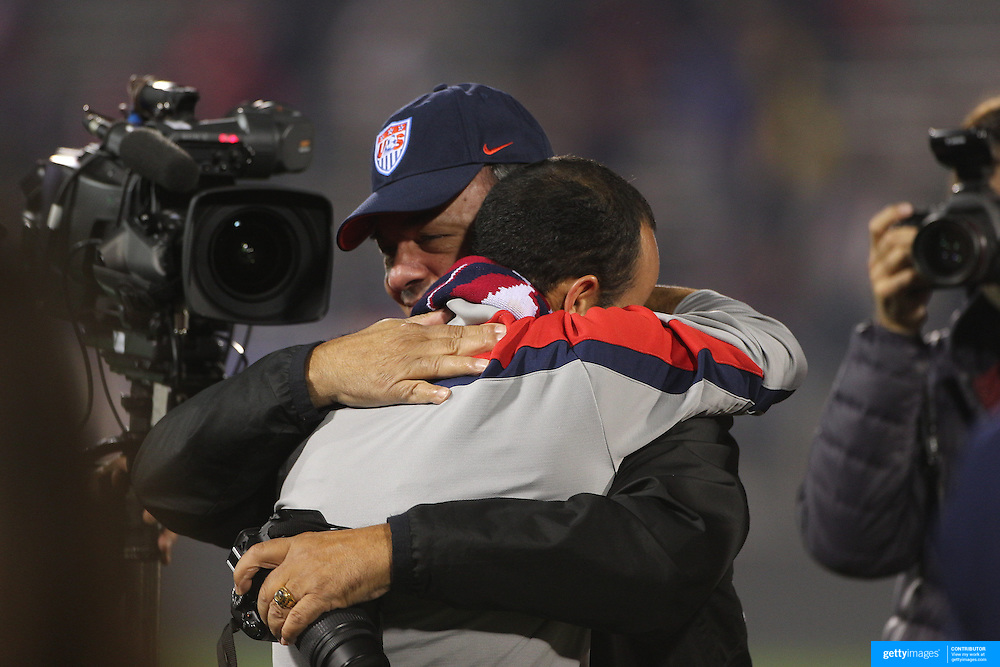 An emotional Landon Donovan, USA, shares a moment with his father Tim Donovan after his farewell match during the USA Vs Ecuador International match at Rentschler Field, Hartford, Connecticut. USA. 10th October 2014. Photo Tim Clayton