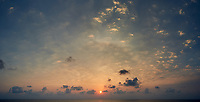 Sunrise over the Caribbean Sea. Composite of three images taken with a Nikon D3s camera and 24 mm lens (ISO 200, 24 mm, f/16, 1/60 sec. Raw images processed with Capture One Pro and AutoPano Giga Pro