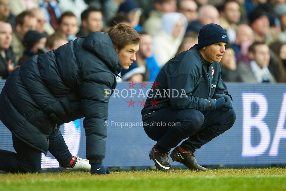 LONDON, ENGLAND - Sunday, February 8, 2009: Arsenal's unused substitutes Aaron Ramsey and Andrey Arshavin during the Premiership match against Tottenham Hotspur at White Hart Lane. (Mandatory credit: David Rawcliffe/Propaganda)